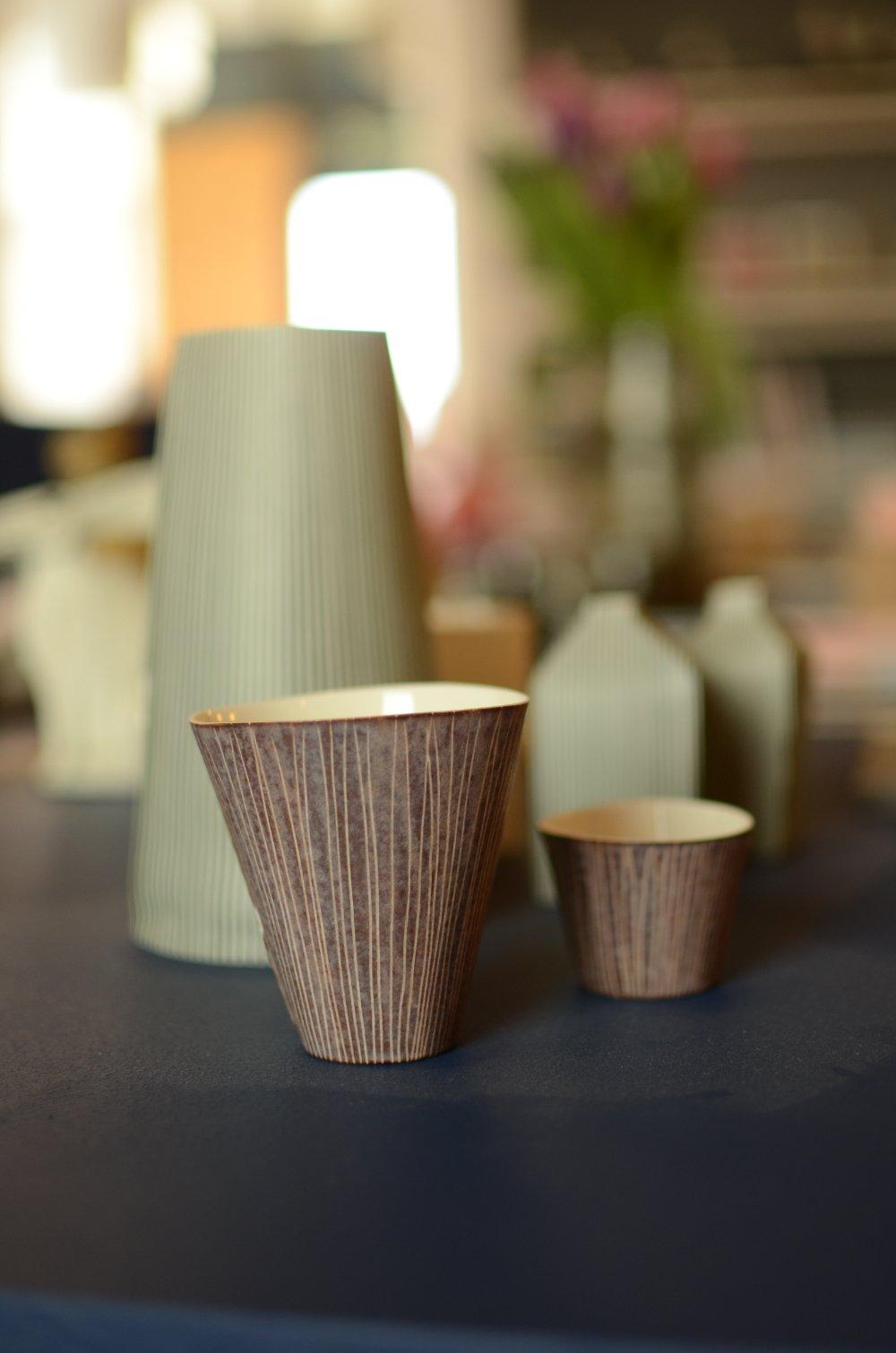 Tall, porceline vessels by Justine Allison