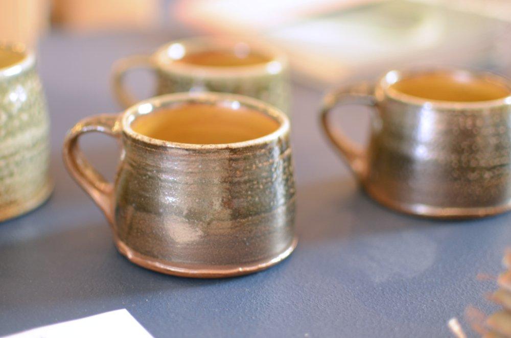 Small, earth coloured salt glazed cup by Micki